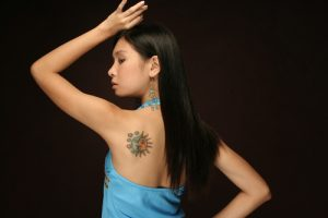 asian girl with sun and moon tattoo
